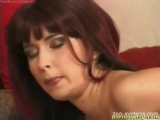 Naked milf shows off in a slutty scene along her dog