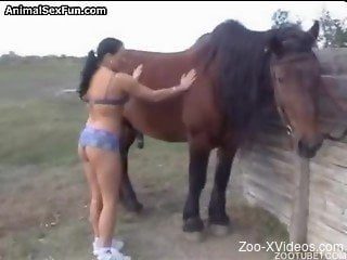 Fine brunette throats large horse cock in outdoor