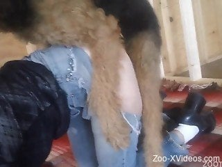 Woman with pierced cunt fucked hard by a dog