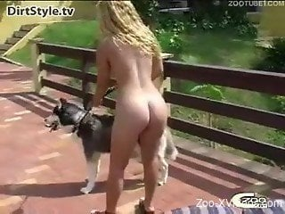 Busty female outdoor sex with a fulffy dog