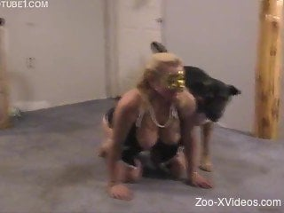 Playful blondie zoophile plays and bangs with a big dog