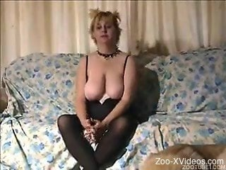 Busty slut is sucking meaty dog dick with love