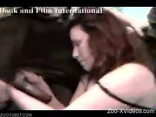 MILF zoofil blows a big dog cock and gets banged