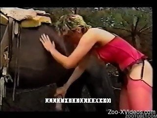 Busty short-haired blonde gives a blowjob for a horse