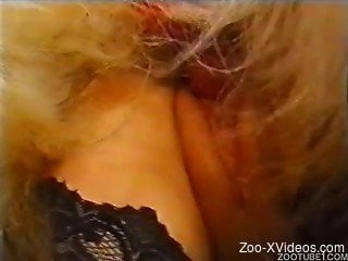 Kinky zoophilia between a hot brunette and her dog