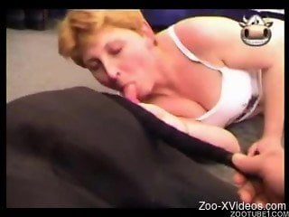 Good-looking blonde gives her black doggy a gorgeous blowjob