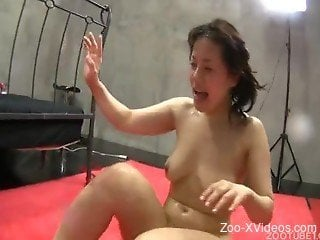 Dark-haired Asian whore fucks with a dog in jav bestiality
