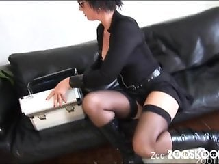 Beauty in black glasses gives her doggy a passionate blowjob