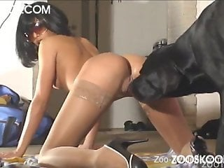 Passionate hottie with round ass fucks with a black dog
