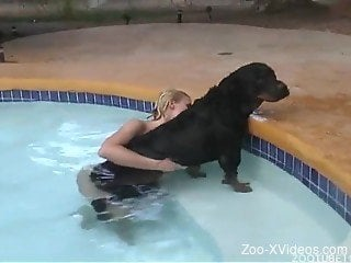 Wet doggy and naked blondie zoophile have awesome sex on the p...
