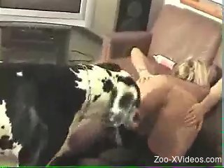 Sexy nude blonde feels entire dog's cock in her pussy
