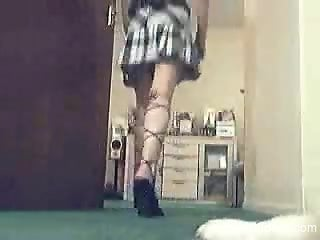 Skirt-wearing girl seduces her dog and gets fucked hard