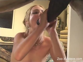 Blonde with tattoos doing her best to make a horse cum