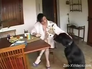 Short-haired brunette cumming with a dog cock in her mouth